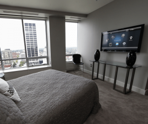 bedroom with tv and speaker setup