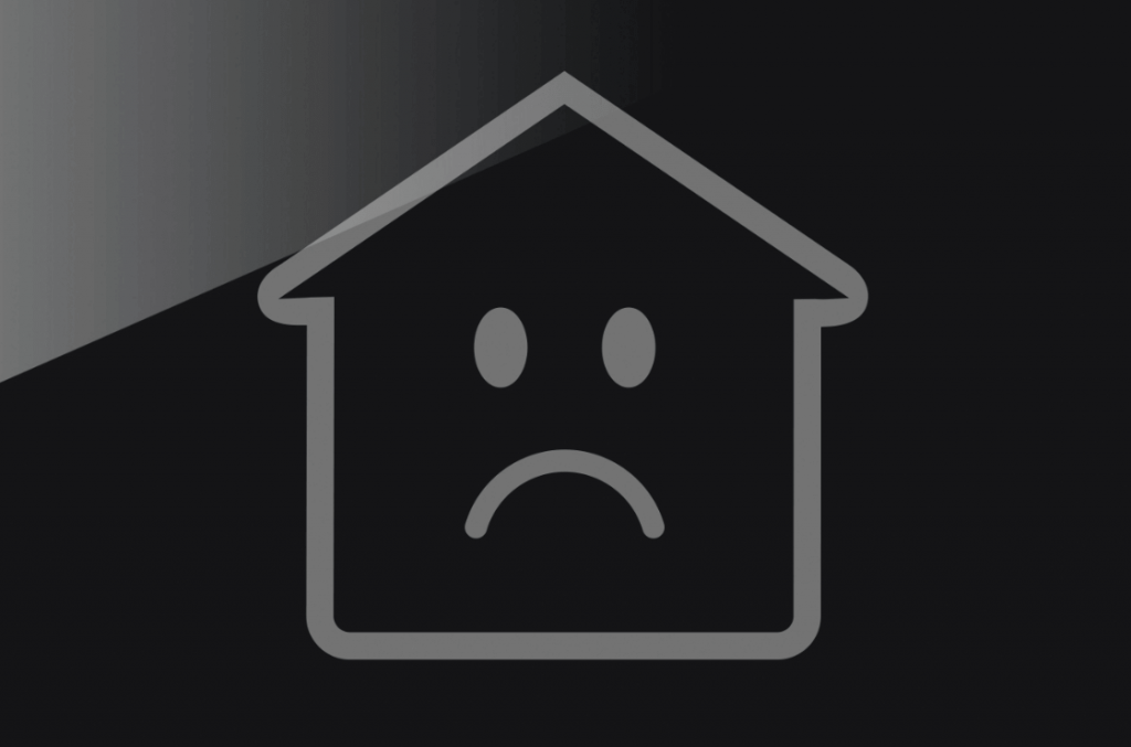 outline of house with a sad face