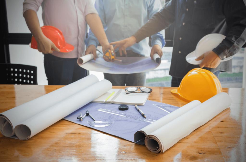 builders looking at floor plans