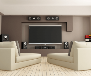 living room with large flat screen tv and speaker system