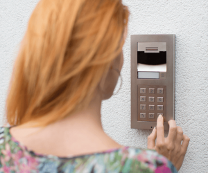person using a pin entry system for their home