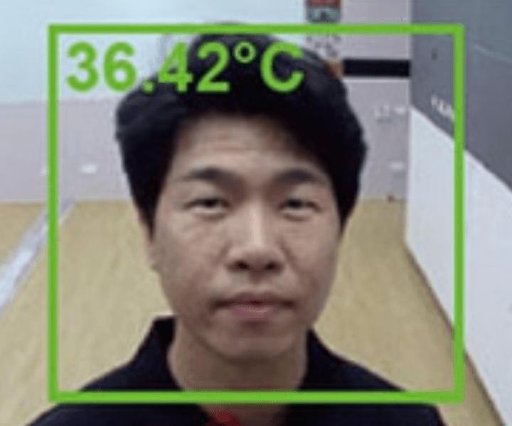 camera checking someones temperature